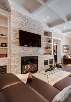 A fireplace is a stunning addition to any home but with so many fireplace designs to pick from finding the proper style may be a small challenge. diy Family room Stunning Family Room ideas with Fireplace Stone Fireplace Wall, Stacked Stone Fireplaces, Fireplace Built Ins, Home Fireplace, Fireplace Remodel, Living Room With Fireplace, Fireplace Design, Stone Wall Living Room, Fireplace Ideas