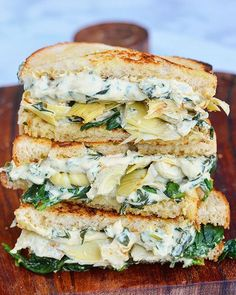 Vegan Artichoke ricotta grilled cheeses by @alexafuelednaturally Vegan spinach almond Ricotta Ingredients: 1 (14 ounce) package of firm tofu 1 cup raw almonds 1/2 tsp salt 4 tbsp nutritional yeast 1/2 tbsp garlic powder 1/2 tbsp onion powder 1/4 tsp pepper 3 cups chopped spinach 1/2 cup unsweetened almond milk Method: Bring a small pot of water to a boil. Place your raw almonds into the boiling water. Let boil for 2 minutes. Drain the almonds immediately in a colander or strainer and rinse…