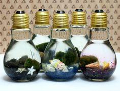 These easy Marimo moss ball DIY light bulb aquariums make a great home for tiny Japanese Marimo moss balls and are super cute as homemade Christmas gifts!