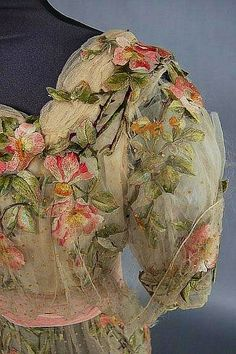 """Belle Epoch Gown: """"onepiece cream silk chiffon w/ pale printed  flocked rose blossom clusters in soft colors, CF net panel covered w/ irridescent sequins  metallic copper coils in floral motifs, embroidered net lace insets on bodice  at hem, chiffon lining, fair. BROOKLYN MUSEUM"""" AA"""