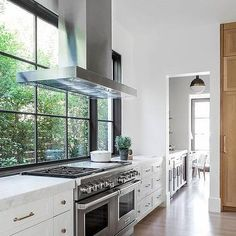 KItchen Range Hood Placed in Front of Windows