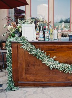 Garland covered bar: http://www.stylemepretty.com/2016/06/06/a-sonoma-wedding-inspired-by-old-world-tuscany/   Photography: Michele Beckwith - http://michelebeckwith.com/
