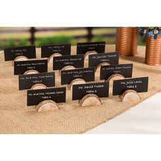 These rustic, half-moon, wooden card holders boast a natural look and texture that add an unforgettable element to your outdoor wedding. Use these wooden holder