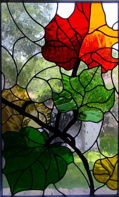 "Contemporary Leaves Fall...    Stained glass panel framed with metal    20"" wide x 30"" tall"