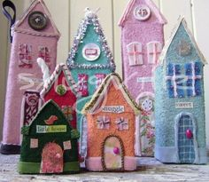 Artist Amy Larson creates each little snug from scratch out of vintage materials.  Snugville's lovely little houses!