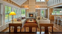 Open Living - Sponsored: Marvin Windows and Doors - Southernliving. Custom Double Hung windows are an essential design element and inspired this modern rustic living room. Cottage Plan, Lake Cottage, Cottage Homes, Lakeside Cottage, White Cottage, Windows And Doors, High Windows, Living Room Designs, Living Rooms