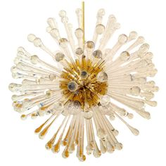 Venetian Dandelion Chandelier Italy 1970  A beautiful brass and blown glass chandelier with over 160 glass elements. 12 light sources. Restored. Rewired. Price $6,800