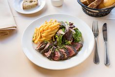 Onglet steak a la Parisienne: French fries, haricots verts, & red wine shallots sauce