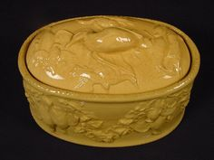 The molded detail in the base and lid is exceptional. The lid has vent holes to vent steam during baking. This is an exceptional piece of yellow ware that would enhance any collection. Stoneware Crocks, Antique Stoneware, Antique Pottery, Mccoy Pottery, Earthenware, Pottery Art, Vintage Bowls, Vintage Dishes, Vintage Kitchen