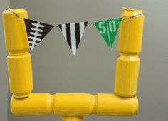 Love the idea of using empty soda cans to make a field goal post, perfect for Super Bowl party decorations!