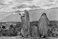 "'The Family of Man""  Muslim women on the slopes of Hari Parbal Hill, praying toward the sun rising behind the Himalayas in Srinagar, Kashmir 1948 by Henri Cartier-Bresson"