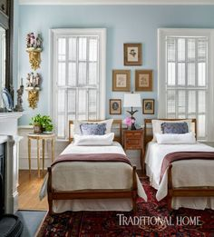 A Georgia Cottage Twin beds occupy the Napoleon-themed guest bedroom.  Gilded wall corbels hold statues of Napoleon and his generals.  The soft blue hue on the walls offers a serene respite for guests.