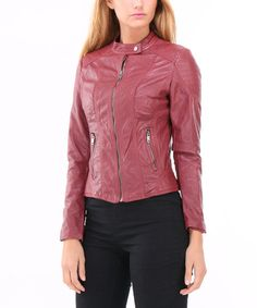 This edgy faux leather jacket features a simple center zipper closure. A strap detail at the neckline adds trendy flair and keeps the wind sealed out.   Shipping note: This item is shipping internationally. Allow extra time for its journey to you.