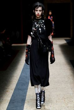 Prada Fall 2016 Ready-to-Wear Fashion Show. surprisingly muted colors and design with the same lace-up and argyle details that make this collection brilliant.