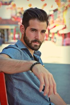 beard, hair, eyes, eyebrows, denim short-sleeve shirt and braclet