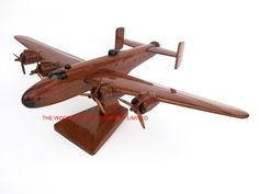 "A beautiful hand carved desktop model of the Halifax Bomber. The model has been carved from solid mahogany. The model comes boxed and is simple to assemble. The wings, tail fins, stand and rotas simply slot into pre-drilled holes on the body of the aircraft. No glue required. Size H 6.5"", L 15"", W 21"". Visit our website at http://www.thewoodenmodelcompany.co.uk to view the full range of our models."