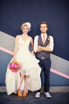 bride and groom.  love their look and her orange shoes !
