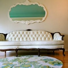 Our antique sofa redone in faux leather - perfect way to have a white sofa with kids!