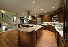 A curved counter and island define this sleek, contemporary kitchen from Conner Homes. The Barbee Mill new home community. Renton, Washington.
