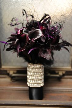 An elegant gothic wedding. Photo by http://michellejohnsonphotography.com, dark bouquet handmade by bride's aunt.