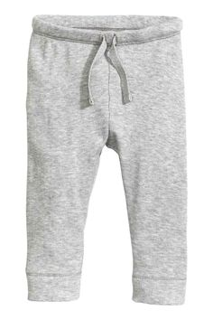 Jersey trousers: CONSCIOUS. Trousers in ribbed,  cotton jersey with an…