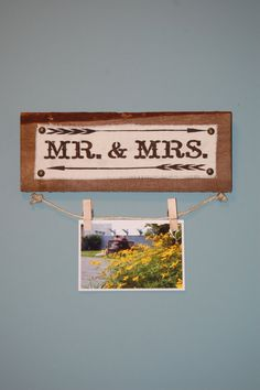 This beautifully crafted Mr & Mrs sign is perfect for an engagement, anniversary, or wedding gift! Item is pictured with a 4 x 6 photo but can fit up to an 8 x 10 vertically. This sign would look great in your home.