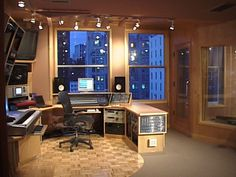 Faux windows with skyline posters in them for a basement studio perhaps?