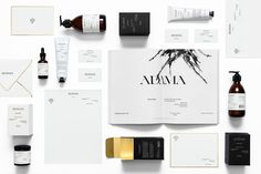Elegant black and white branding for Adama skin-care company with gold detailing.