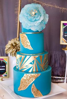 Blue Tiered Decorated Cake on Craftsy