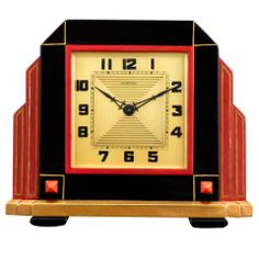 Art Deco by Cartier. This timepiece is housed in a sleek, architectural case, the black and red enameling reflecting Cartier's incredibly popular Oriental aesthetic, as imagined by legendary designer and Art Deco pioneer, Charles Jacqueau.