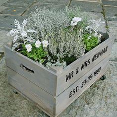 This lovely large personalised apple crate contains a stunning selection of shrubs and flowers in silver and white, specifically themed for a Silver Wedding Anniversary.