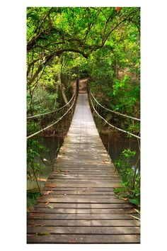 """Home Decor The Bridge Wall Decal by Wow Your Walls  This beautiful peel and stick wall art creates a mysterious and resplendent perspective in any room. An overgrown and enchanted forest reveals a swaying wooden bridge.  - 3 panels  - 6'6"""" W x 9'7"""" L  $61.00"""