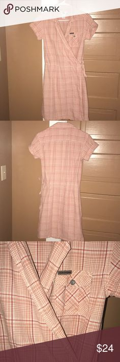 *VINTAGE* Mid 90's CK Dress **VINTAGE** 90's!!!  Item: Wrap Dress Size: Medium  Condition: Great (some wear)  Worn during the 90's Well taken care of   Button on inside of dress String to tie on outside One pocket on chest  Can't tell for sure but looks like there may be a small stain on the inside of the dress near the button. May be able to see from outside also (my eyes are awful). Tried to get a picture but can't get the lighting right to see. **Check out all pictures  Any questions?…