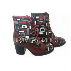 'Geoboot' Size 36 synthetic boots in burgundy have been painted black in sections and then overlaid with a contrasting geometric pattern in white, grey and burgundy.  By Brave Strides.