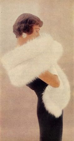 Model in a white fur stole, 1950s.