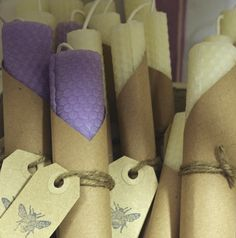 Hand rolled beeswax candles by us. NOTE: brown wrapper, tag