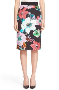 Adding floral blooms to a tailored work ensemble for a feminine touch.