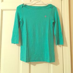 Lilly Pulitzer 3/4 Top Lilly Pulitzer 3/4 Top. 100% cotton. Aqua with a pink Lilly Pulitzer palm tree decal. Lilly Pulitzer Tops