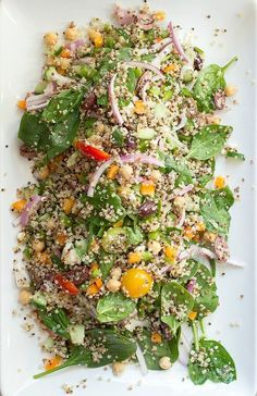 An amazing quinoa salad with baby spinach, peppers, onion and feta cheese then the whole salad is tossed in a red wine vinaigrette for a total power salad.