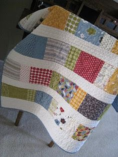 Charm pack baby quilt. Love more modern quilts, especially with lots of white