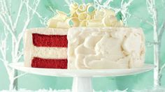 Red velvet cake is a staple on holiday tables across the South, and this is our favorite take on it: two layers of creamy red velvet cheesecake with moist vanilla cake in the middle, all blanketed in a cream cheese frosting. Don't skip the crumb coat of frosting, which keeps the red velvet layer from showing through the frosting.