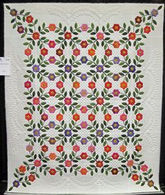 """Garden Wedding"" by Janet Sutton... flower appliques in the shape of wedding rings! 2011 AQS quilt show - Lancaster. Photo by The Noble Wife"