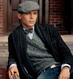 20s look with newsboy cap, bow tie, sweater vest, and shawl collar cardigan.
