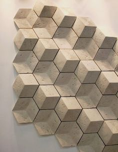 Using tile to add interest to a space is nothing new, but at this years Cersaie, I noted many examples of tiles that had a decorative bent based less on color or strong visual pattern, but rather on high texture and a certain rough-hewn chic