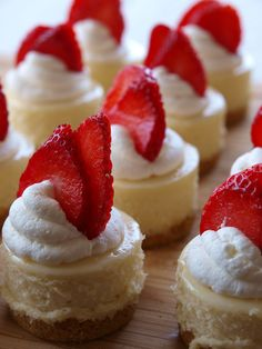 Mini vanilla bean cheesecakes.  Topped with made from scratch whipped cream, and garnished with fresh strawberry slices!  Delicious!