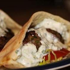 Gyro Meat Sandwich Filling with Tzatziki (Satziki) Sauce on BigOven: These savory meats are seasoned just right for a great pita sandwich!  The cucumber sauce is spooned liberally on top, and may also may be served as a side dish to any lamb dish.