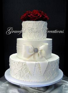 Elegant White Butter Cream Wedding Cake with Fondant Sash and Bow