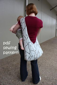 inspired by those baby slings you see that distribute the baby's weight across one shoulder with a super wide strap – no more cutting into your shoulder or groaning under the weight.