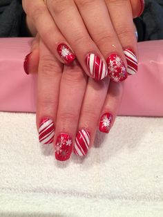 Candy cane and snowflake acrylic nails with shellac done byTrine Fajardo at California Nails & Beauty Lounge #californianails #beautylounge #christmas #christmasnails #nails #negler #naglar #acrylicnails #shellac #nailart #jul #julenegler #cnd #opi #red #glitter #snowflakes #candycanes
