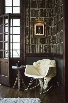 From the library wall paper, to the pops of modern white in a moody atmosphere, this is an intriguing home.